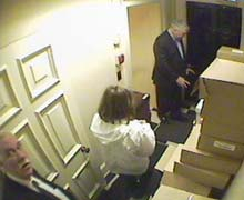Black, assistant Joan Maida and chauffeur John Hillier removing boxes from Hollinger Inc.
